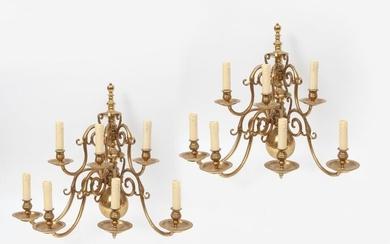 Pair of brass sconces with seven coiled light arms.
