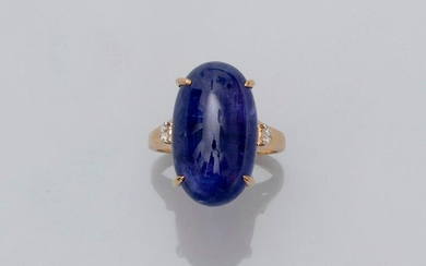 Ring in white gold, 750 MM, decorated with an oblong tanzanite cabochon weighing about 20 carats, with diamonds, size : 54, weight : 7,1gr. rough.