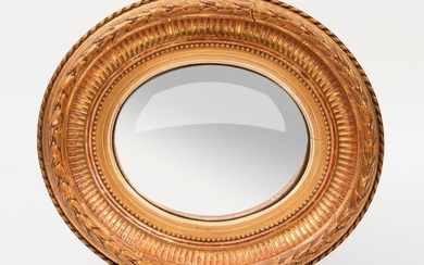Small oval shaped witch mirror with a gilded...