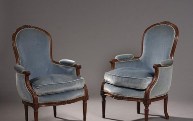 TWO CONVERTIBLE BERGERES of close models in beech wood moulded and carved with ribbon knots. Tapered fluted front legs with roughened grooves, rear legs curved for one of the shepherds.