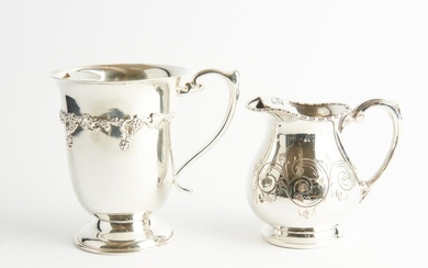 TWO HEAVY SILVER PLATED WATER JUGS WITH ICE CATCHERS AND ENGRAVED AND CAST DECORATION, ONE BY COOPER BROTHERS AND THE OTHER CRUSADER...