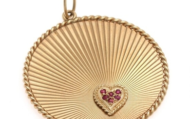 SOLD. Tiffany & Co.: A ruby pendant of 14k gold set with numerous circular-cut rubies....