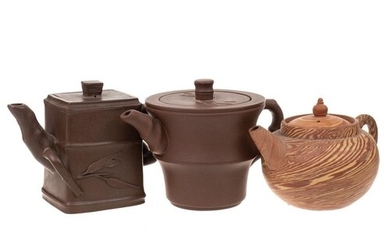 Two small Chinese Yixing stoneware teapots: of dark brown hu...