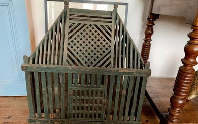 Wooden cage painted green patina.