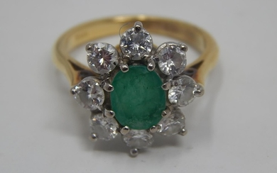 18ct Gold Emerald & Diamond Ring: Set with a central oval cu...