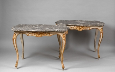 A pair of Rococo style hardwood tables