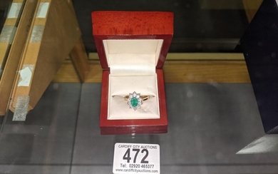 A 18K yellow gold Emerald and Diamond ladies ring