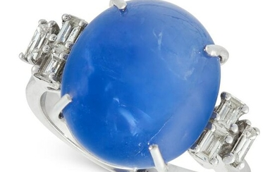 A BURMA NO HEAT STAR SAPPHIRE AND DIAMOND RING in 18ct