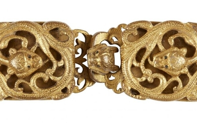 A Chinese archaistic gilt bronze belt buckle, 18th century, cast...