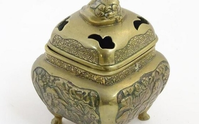 A Chinese lidded cast brass censor of squat form with