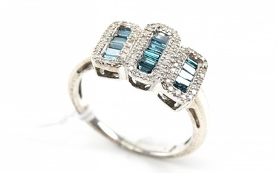 A DIAMOND AND BLUE STONE DRESS RING IN STERLING SILVER
