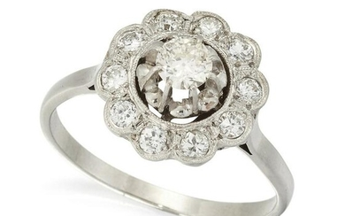 A DIAMOND CLUSTER RING, the central old cut diamond, in