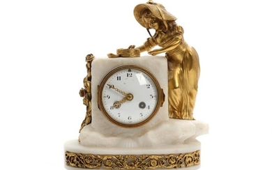 A French bronze and alabaster mantel clock, a young lady standing by a bird nest. Early 20th century. H. 27 cm.