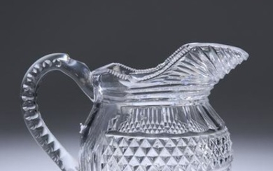 A GEORGIAN CUT-GLASS WATER JUG, with hobnail cut band