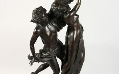 A LARGE BRONZE GROUP, a young man embracing a semi-nude