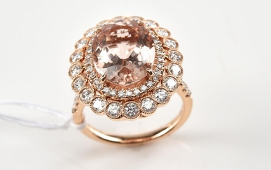 A MORGANITE AND DIAMOND COCKTAIL RING - Featuring an oval cut morganite weighing 5.11ct, surrounded and shouldered by round brillian...