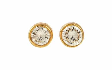 A PAIR OF DIAMOND SOLITAIRE STUD EARRINGS, with diamonds of ...