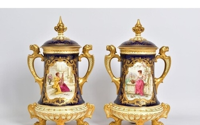 A PAIR OF EARLY 20TH CENTURY COALPORT TWIN HANDLED URNS AND ...