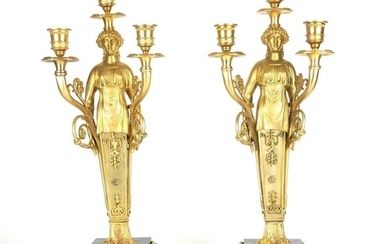 A PAIR OF EMPIRE STYLE GILT BRONZE FIGURAL THREE BRANCH CAND...