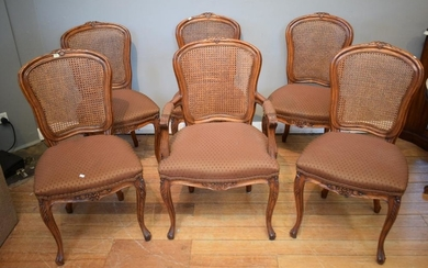 A SET OF SIX FRENCH STYLE RATTAN BACK DINING CHAIRS INCLUDING ONE CARVER (A/F STAINING TO FABRIC)