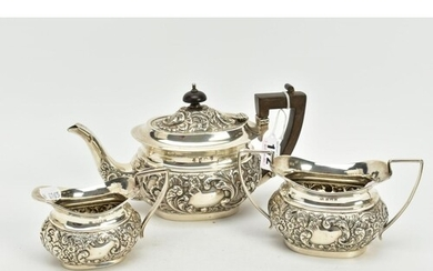 A SILVER THREE PIECE TEA SET, to include a floral embossed, ...