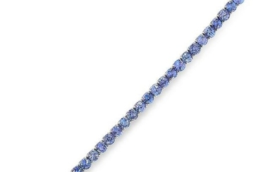 A TANZANITE LINE BRACELET in 18ct white gold