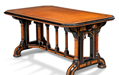 A VICTORIAN AMBOYNA AND EBONISED CENTRE TABLE