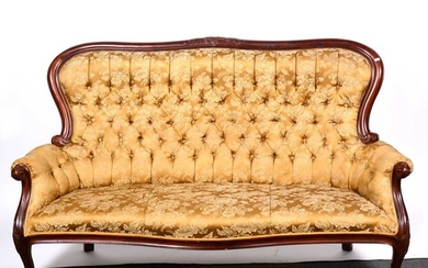 A Victorian mahogany sofa, upholstered in buttoned Old Gold brocade