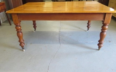 A Victorian pine and mahogany kitchen table on turned legs, ...