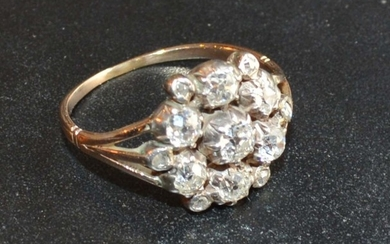 A Yellow Metal Diamond Cluster Ring with seven diamonds and ...