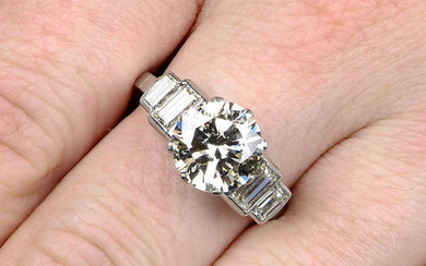 A brilliant-cut diamond single-stone ring, with baguette-cut diamond stepped shoulders.