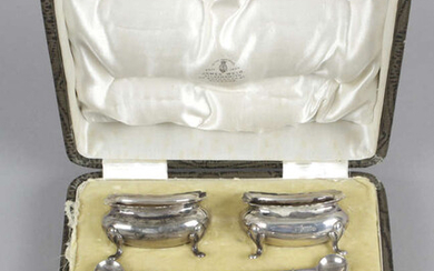 A cased set of four Edwardian silver salts & matched spoons, plus a late Victorian pepper pot and three modern weighted examples.