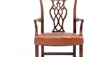 NOT SOLD. A circa 1900 nut and mahogany armchair, back with carvings, seat with leather...