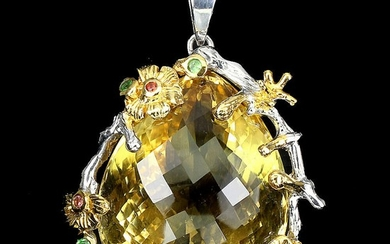 A citrine pendant set with a pear-shaped citrine and smaller circular-cut sapphires and tsavorite garnets, mounted in rhodium- and gold plated sterling silver.