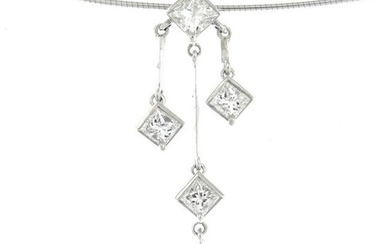 A diamond triple drop pendant, suspended from an 18ct