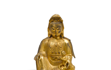A gilt copper alloy seated figure of the Songzi Guanyin