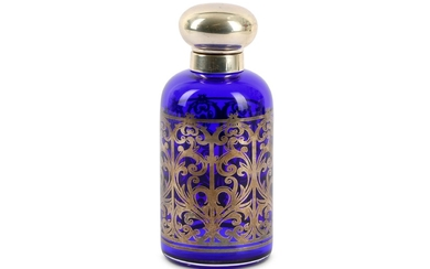 A modern blue glass silver overlay scent bottle
