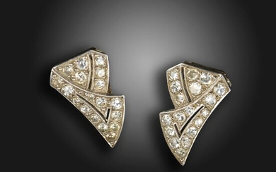 A pair of Art Deco French diamond double clip earrings, the pierced stylised ribbons millegrain-set with single-cut diamonds in platinum with white gold clip fittings, French control marks, 1.8cm high