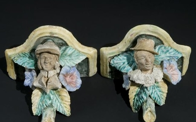 A pair of Art Nouveau polychrome ceramic shelves
