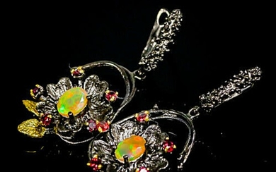 A pair of ear pendants each set with numerous oval and circular-cut opals and rhodolite garnets, mounted in black rhodium and gold plated sterling silver. (2)