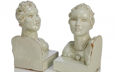 A pair of glazed terracotta bookends, possibly Austrian and in...