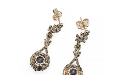 A pair of sapphire and diamond ear pendants each set with a circular-cut sapphire and numerous rose-cut diamonds, mounted in 14k gold and silver. (2)