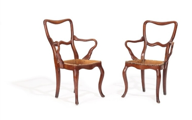A pair of stained beech armchairs, curved armrests and cabriole legs. 19th century. (2)