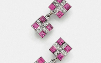 A pink sapphire, diamond and platinum pair of cufflinks, circa 1920.