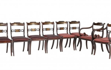 A set of eight Regency simulated rosewood and brass inlaid dining chairs