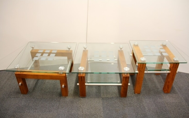 A set of three contemporary steel and plate glass coffee tables, 70 x 70 x 44cm.