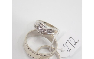 A white gold diamond ring and two white gold band rings appr...