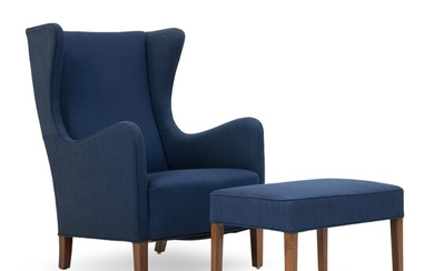 A.J. Iversen: Wingback easy chair with matching stool of Brazilian rosewood. Upholstered with blue wool....