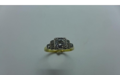 An 18ct and platinum diamond ring, the central stone approx ...
