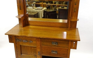An Arts and Crafts golden oak mirror-back sideboard, circa 1...